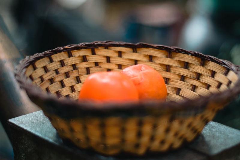 Close-up of oranges in basket