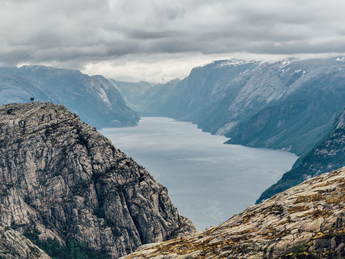 Beauty In Nature Cloudy Day Fjord Landscape Moody Mountain Mountain Range Nature No People Norway Outdoors Physical Geography Preikestolen Pulpit Rock Rock - Object Scandinavia Scenics Sky Tranquil Scene Wilderness