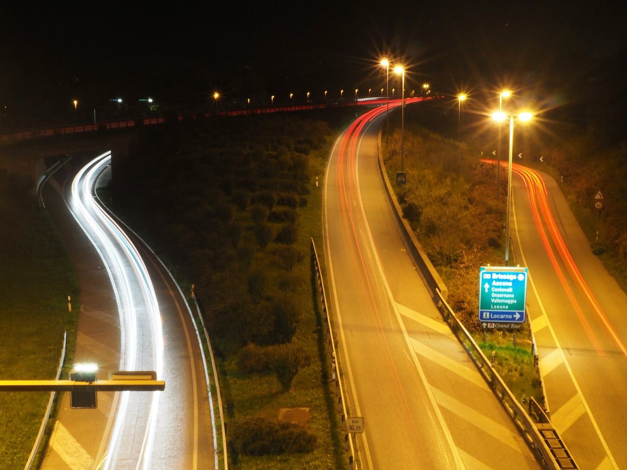 illuminated, night, light trail, speed, motion, long exposure, road, street light, transportation, traffic, street, blurred motion, high angle view, no people, car, outdoors, land vehicle, high street, city