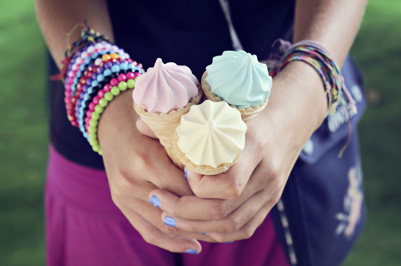 Close-Up Of Hands Holding Ice Cream Cones