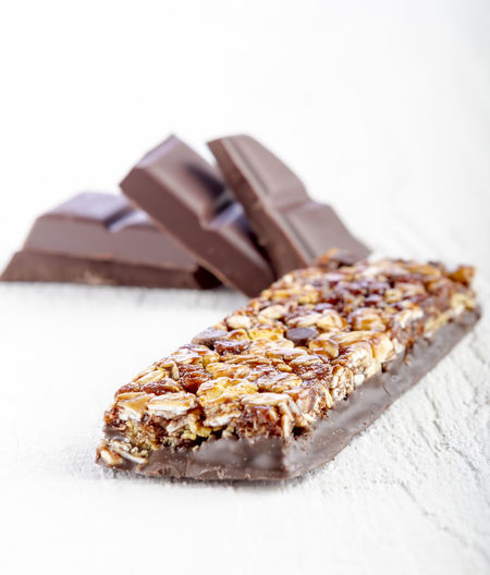 Sweet Food Food And Drink Food Protein Bar Chocolate Dessert Sweet Ready-to-eat Nut White Background Indulgence Freshness Studio Shot Close-up Indoors  Temptation Baked Nut - Food No People Chocolate Bar Snack Dieting Cereal Bar