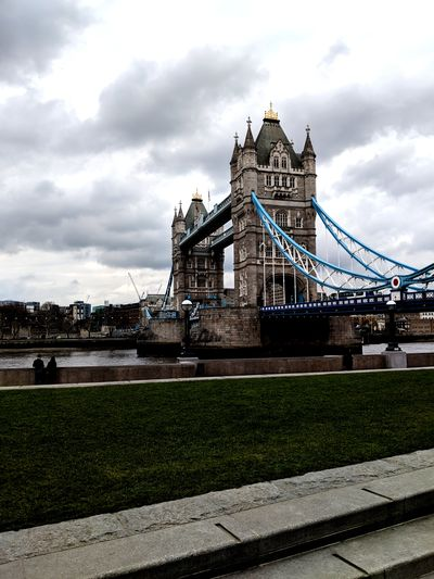 View of tower bridge against cloudy sky