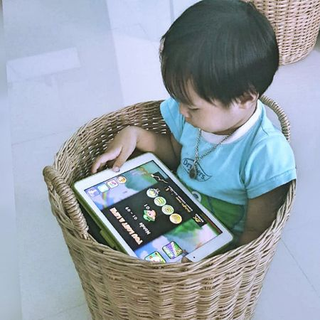 Internet Addiction Wireless Technologyplaygame Communication Indoors  Technology Connection Smart Phone Portable Information Device Holding Casual Clothing Person Memories Hobbies Kid Kids Having Fun Kids Portrait Samutprakarn In Thailand