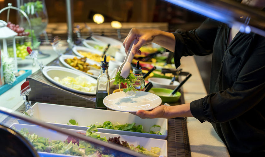 woman hands holding tweezers and dish rocket salad in the restaurant. Dish Fine Art Photography Hands Nature Salad Woman Dressing Eat Female Fresh Healthy Eating Kitchen Salad Bar