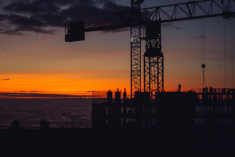 Sunset Sky Silhouette Water Sea Orange Color Machinery Nature Architecture Crane - Construction Machinery Industry Cloud - Sky Construction Industry Built Structure No People Scenics - Nature Development Beauty In Nature Outdoors Construction Equipment