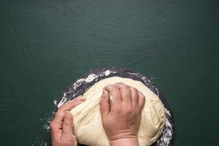 High angle view of woman hand over sea