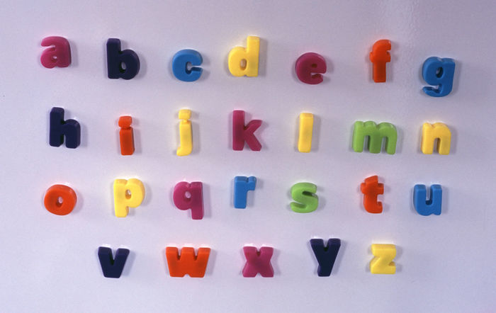 magnetic fridge letters ordered into the alphabet Alphabet Blue Charachter Close-up Coloured Cyan Green Indoors  Letter Letters Multi Coloured Multicolour Red Refrigerator Toy Type White Yellow