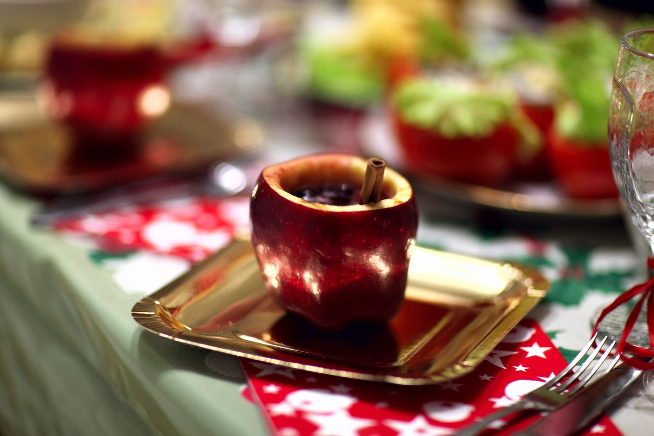 Apple drink served in plate on table during christmas