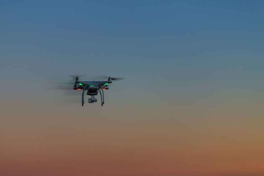 Air Vehicle Blue Clear Sky Copy Space Day Drone  Flying Mid-air Mode Of Transportation Motion on the move Outdoors Sky Sunset Transportation