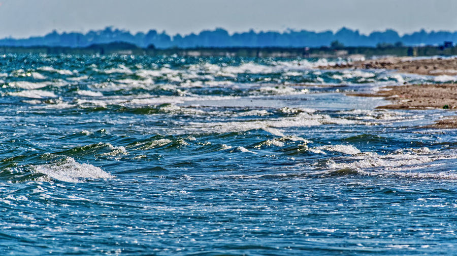 Water Sea Waterfront Motion Wave Beauty In Nature Day Nature No People Sport Outdoors Scenics - Nature Sky Aquatic Sport Blue Selective Focus Swimming Land Beach Turquoise Colored Marine