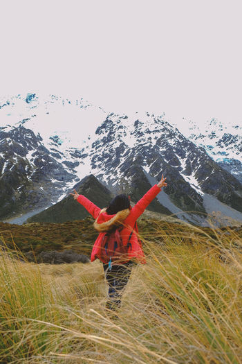 Mountain One Person Beauty In Nature Scenics - Nature Winter Leisure Activity Environment Real People Mountain Range Day Standing Snow Adventure Arms Raised Freedom Outdoors Warm Clothing Glade Cheering Feeling Good Rear View Full Length Portrait Mount Cook New Zealand Snow Mountain