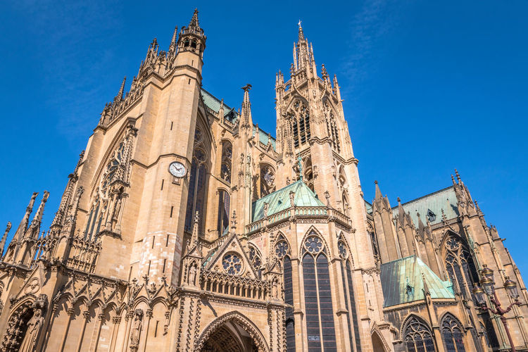 Metz Cathedral in France Metz Metz, France Architecture Baroque Style Blue Building Exterior Built Structure City Clock Day Gothic Style History Low Angle View Metz Cathedral No People Outdoors Place Of Worship Religion Sky Spirituality Travel Destinations
