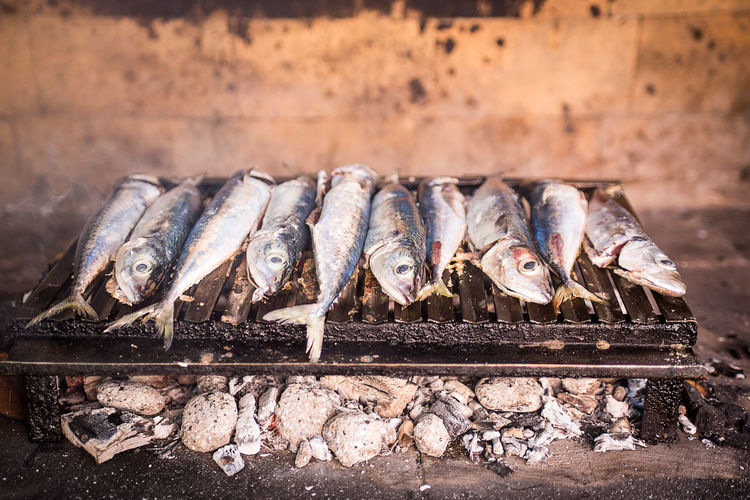 Close-up of fish roasting on barbecue grill