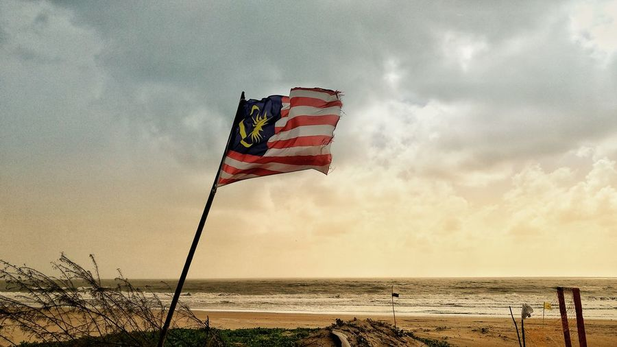 raise the flag #cherating #malaysia Water Sea Beach Sand Flag Wind Sky Horizon Over Water Cloud - Sky