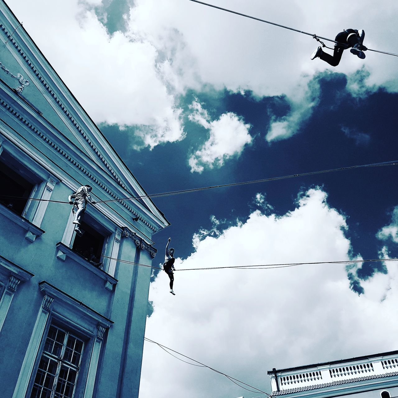 low angle view, sky, cloud - sky, cable, day, built structure, outdoors, building exterior, architecture, hanging, no people