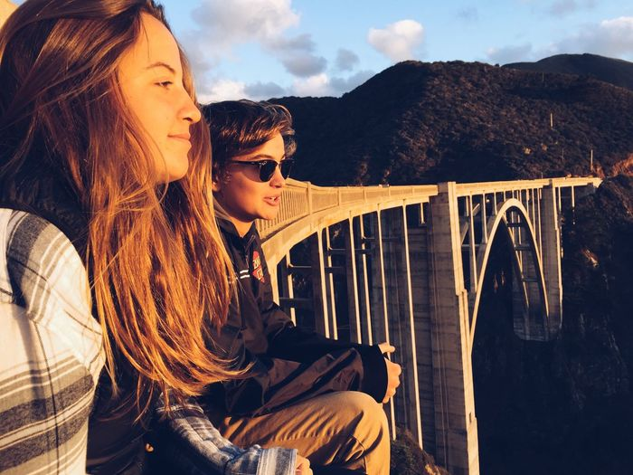 Young Women Sitting By Bixby Bridge
