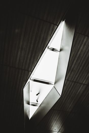 Low angle view of illuminated lighting equipment in building