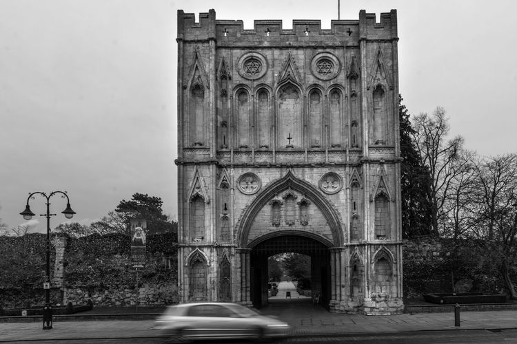 The 14th Century Abbey Gate in Bury St Edmunds, Suffolk, UK The Abbey Gate Bury St Edmunds Bury St Edmunds Abbey Ruins Architecture Built Structure Arch Building Exterior The Past History Black And White Black And White Architecture 14th Century Old Buildings Old Building Exterior Medieval Architecture MedievalTown