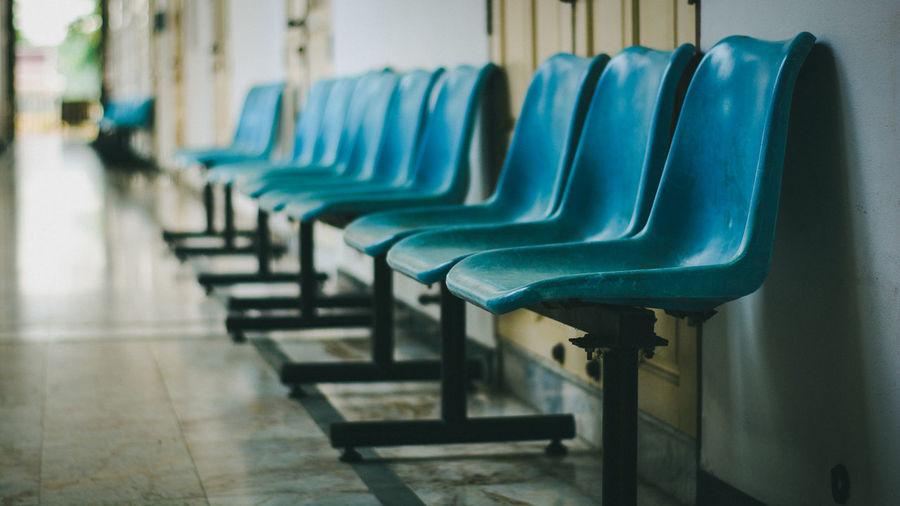Empty chairs in corridor