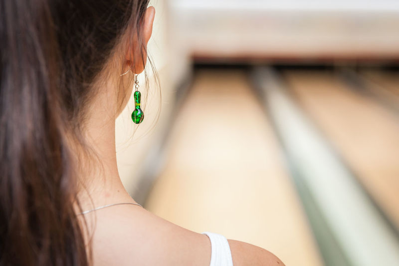 Close-up of woman wearing earrings