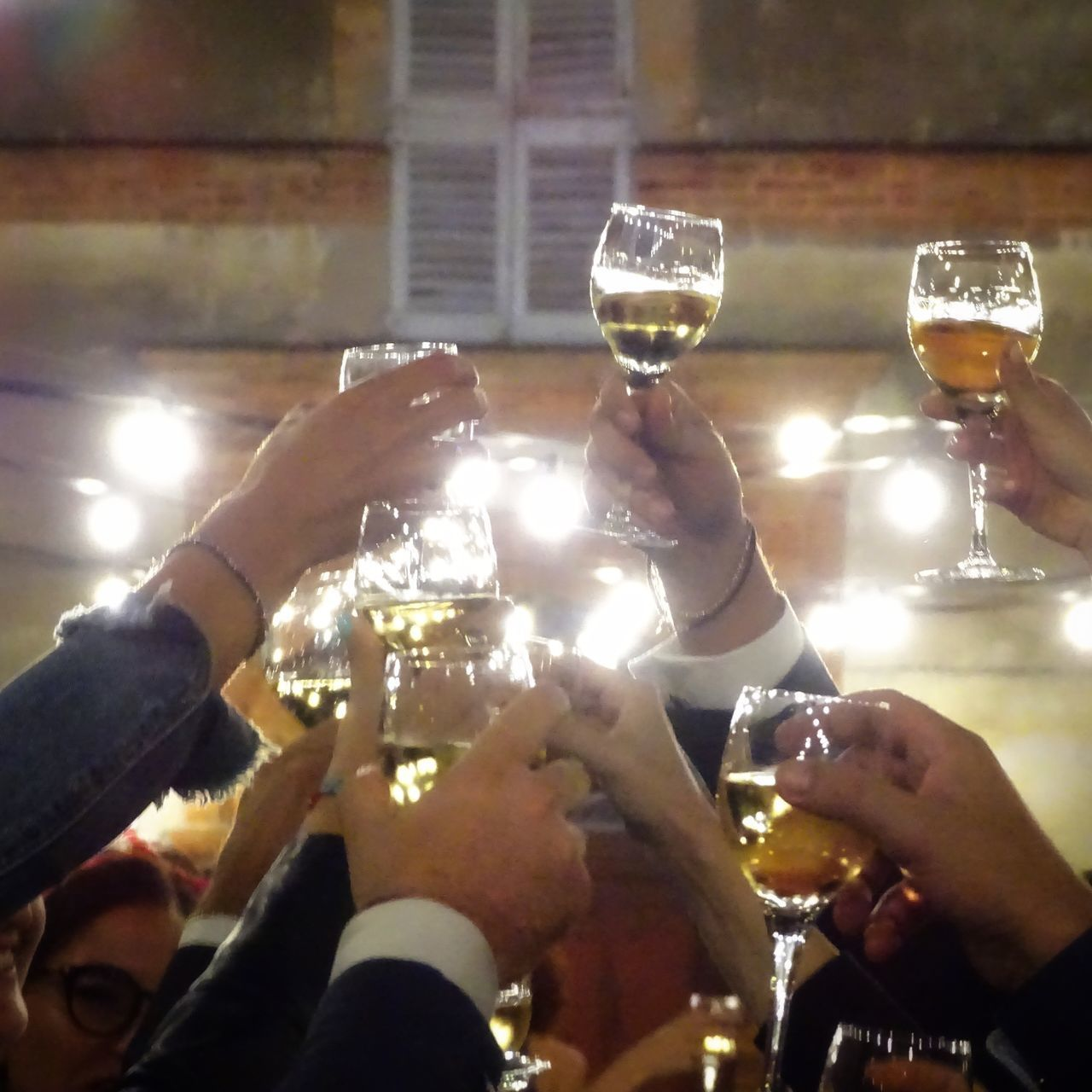 GROUP OF PEOPLE IN DRINKING GLASS AGAINST THE BACKGROUND