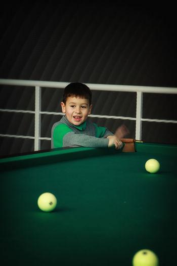 Cute boy plating pool