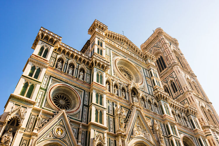 Low angle view of duomo santa maria del fiore against clear sky in city