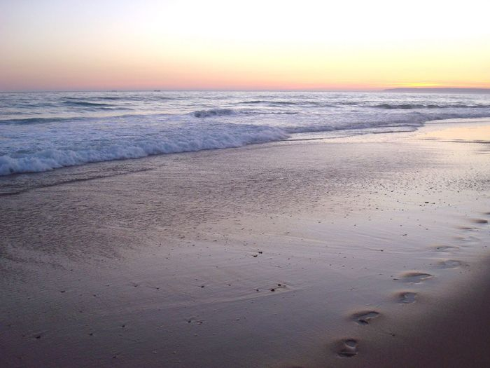Beach Sand Shore Coastline Sea Horizon Over Water Vacation Footprints Summer Water Seascape Ocean Sunset Waves Atmosphere