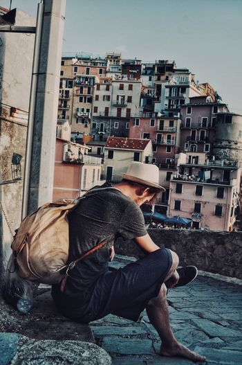 Streetphotography Travel Hat Italy Architecture Building Exterior Built Structure Real People One Person Lifestyles Side View Casual Clothing Day Sitting My Best Photo Streetwise Photography