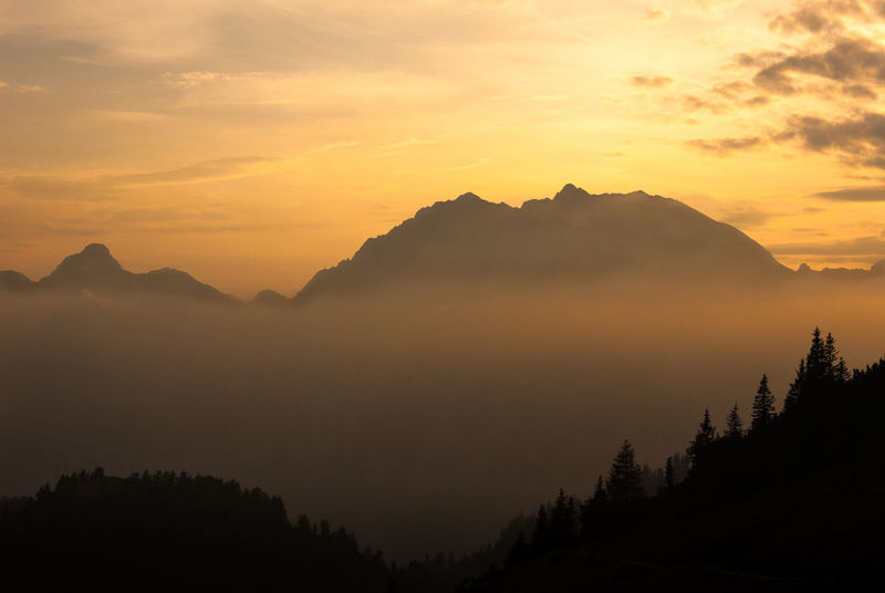 view from a mountain hut at sunset Beauty In Nature Day Dusk Golden Hour Landscape Mountain Mountain Range Mountains And Sky Nature No People Outdoors Scenics Silhouette Sky Sunset Tranquil Scene Tranquility Tree Alps