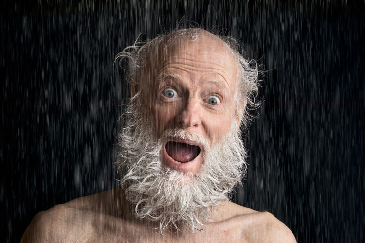 happy senior man taking a shower Excitement White Hair Black Background Indoors  Facial Hair Studio Shot Gray Hair Front View Shouting Beard Senior Adult Shirtless One Person Adult Looking At Camera Emotion Mouth Mouth Open Headshot Portrait Shampoo Shower Happy Playful