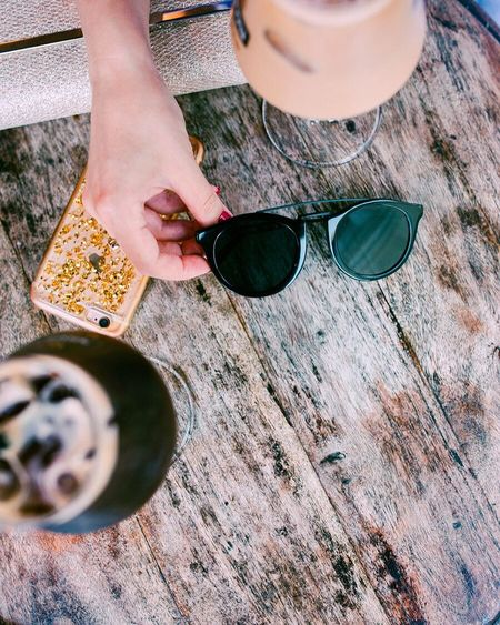From recent photoshoot💁🏻♂️ Human Body Part Sunglasses Human Hand One Person High Angle View Table Wood - Material Day Holding One Woman Only Drink Outdoors Women One Young Woman Only Adult Young Adult Close-up Adults Only Only Women Real People