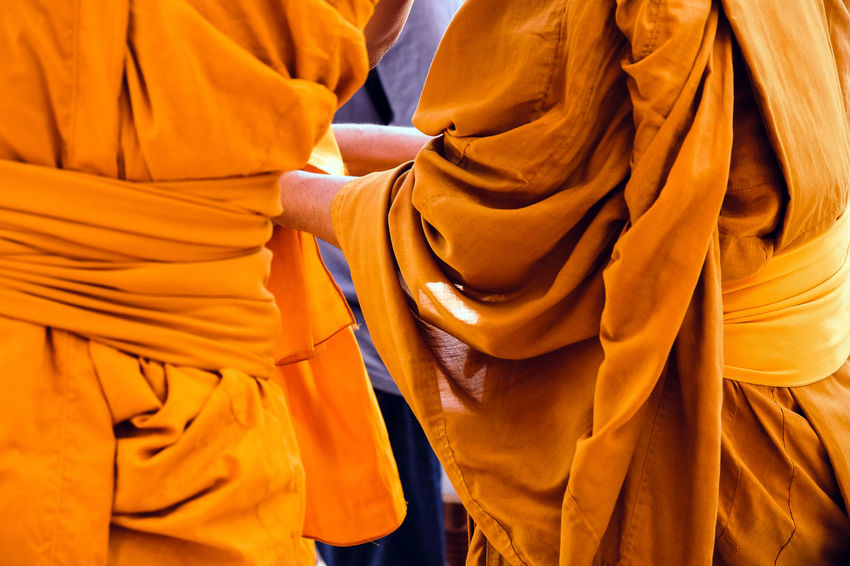 Yellow robe of Buddhist monks, Closeup on buddhist monk Buddhist Buddhist Temple In Thailand Religion And Tradition Religious Art Buddhist Culture Buddhist Monks Buddhist Temple Close-up Clothing Lifestyles Midsection Monk  Monks Orange Color People Real People Religion Religion And Beliefs Religious  Robe Standing Textile Traditional Clothing Yellow Yellow Robe