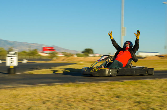 Adult Adults Only Day Go Kart Go Karting Headwear Motion Motion Blur One Person Outdoors People Race Track Sky Sports Track