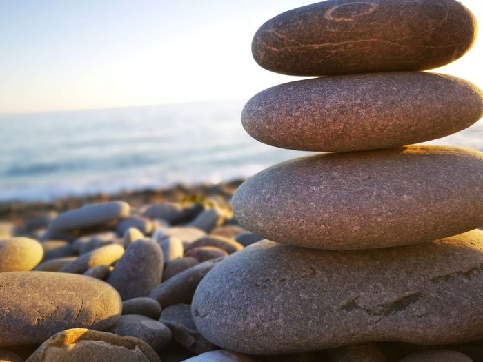 Rock pile by the sea Water Sea Beach Wave Stack Pebble Beach Pebble Sand Balance Rock - Object Stack Rock
