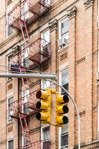 Low Angle View Of Stoplight Against Building