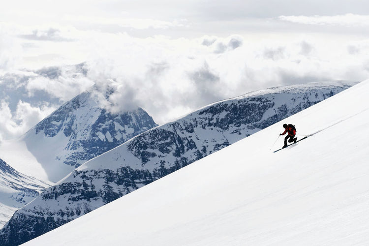 High angle view of people on snowcapped mountains