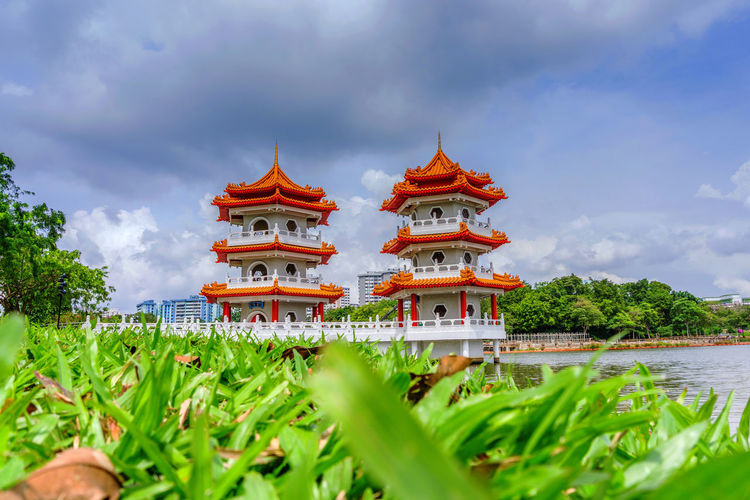 Chinese Garden Twin temple Pagoda Buddhist Travel Architecture Beauty In Nature Building Exterior Built Structure Cloud - Sky Day Grass Green Color Growth Historical Nature No People Outdoors Pagoda Place Of Worship Plant Religion Religion And Beliefs Sky Spirituality Temple Travel Destinations Tree