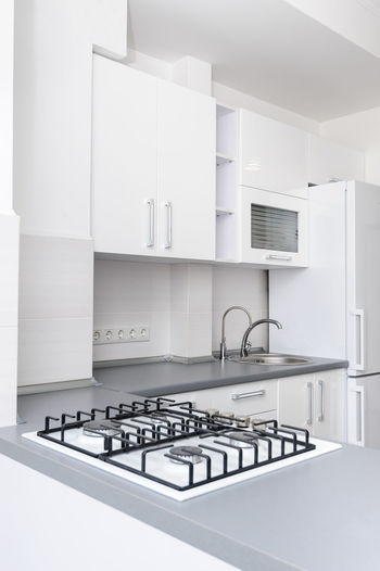 Brand new black and white modern kitchen interior with clean design Appliances Appliance Black Burner - Stove Top Clean Design Domestic Kitchen Domestic Life Domestic Room Faucet Furniture Home Interior Home Showcase Interior Indoors  Kitchen Kitchen Interior Modern No People Oven Stove White Color