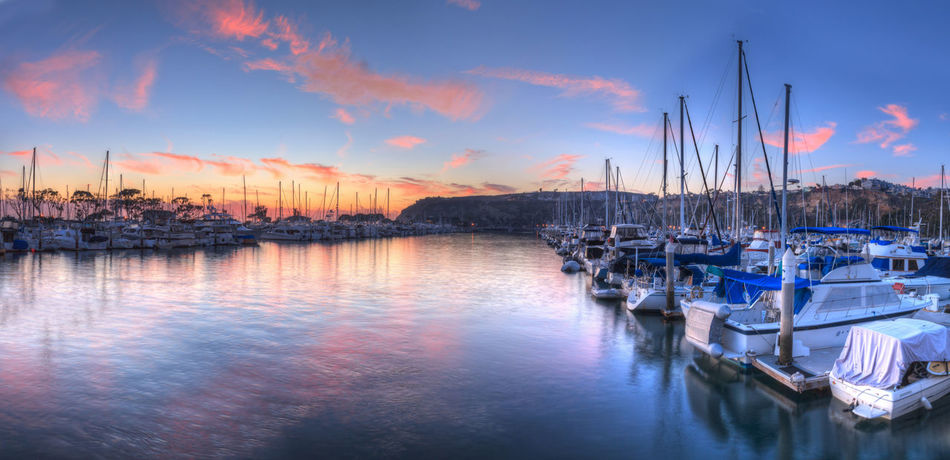 Sunset over sailboats in Dana Point harbor in the fall. Boat California Dana Point Harbor Dana Point, Ca Harbor Nautical Vessel No People Ocean Orange County, Ca Outdoors Panorama Panoramic Reflection Sailboat Ship Sky Sky And Clouds Sunset Transportation Water