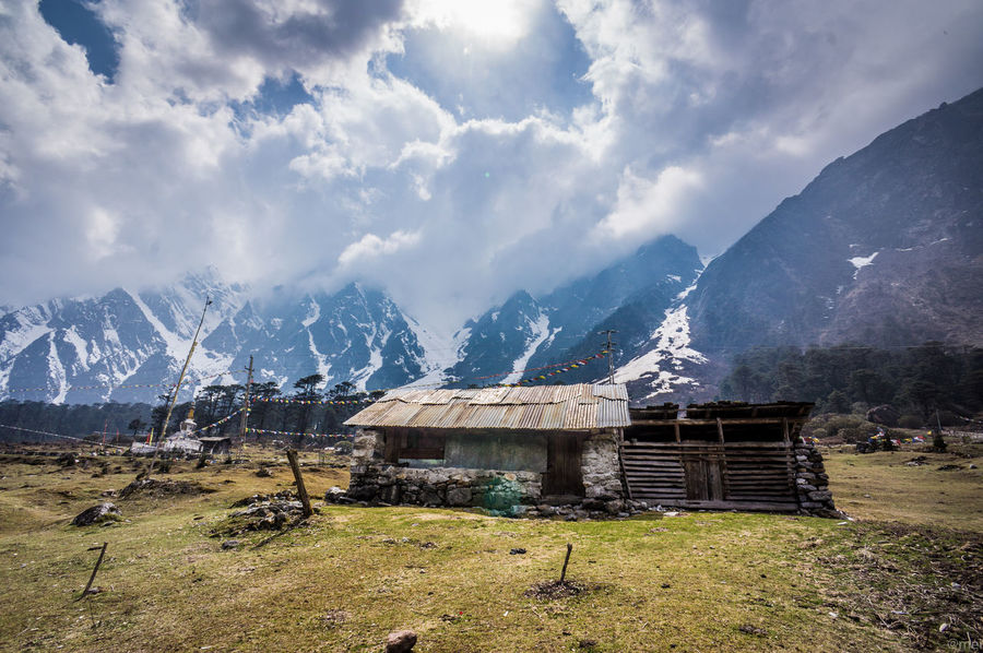 Architecture Beauty In Nature Building Exterior Built Structure Day Grass Landscape Mountain Mountain Range Nature No People Outdoors Peak Range Scenics Sky Snow Tranquility Yumthang Valley