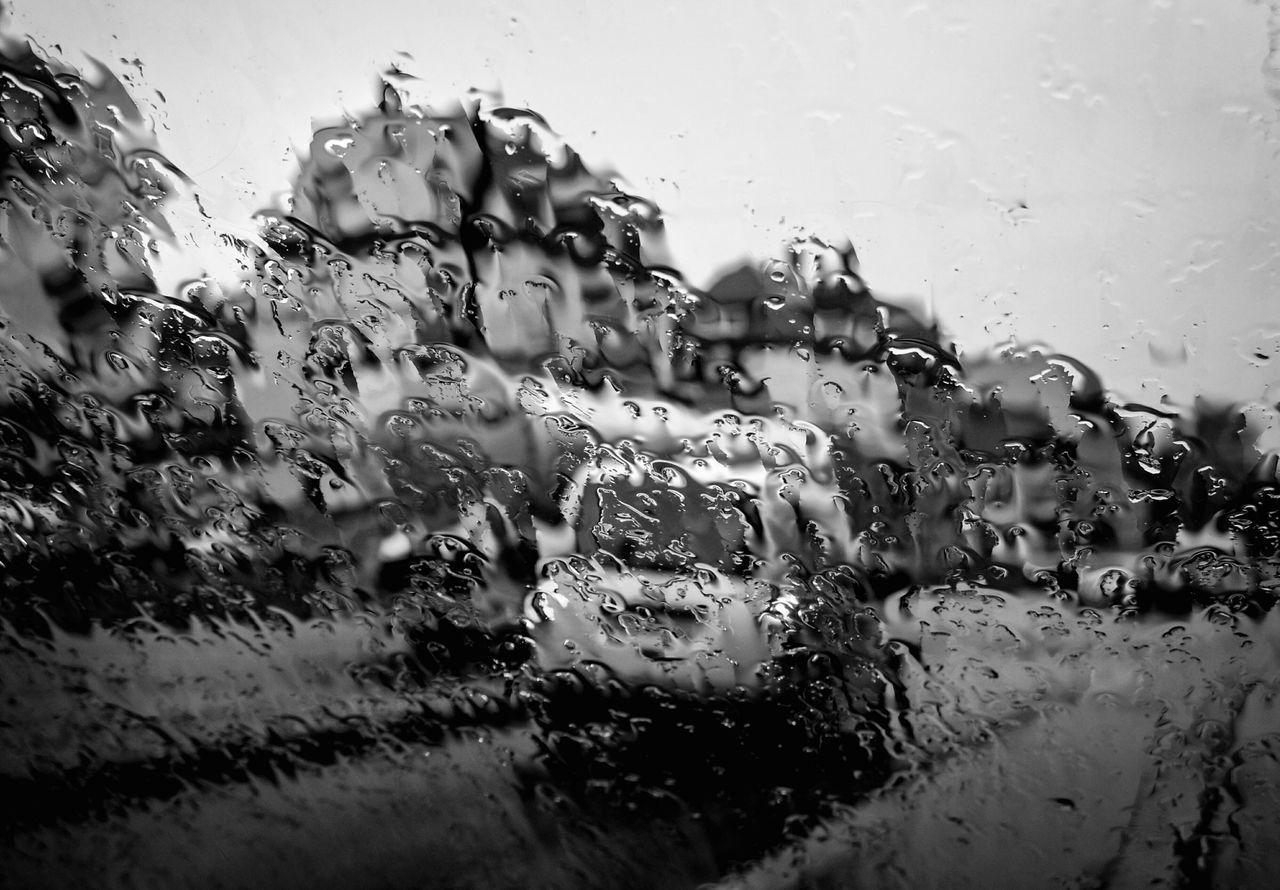 Rain Streaked Window With Street View