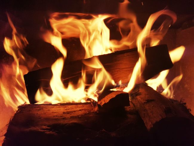 Flame Fire - Natural Phenomenon Burning Heat - Temperature Wood - Material Winter Close-up No People Night Inferno Nature Indoors  Fire Firewood Fire And Flames Flames Kaminfeuer Kaminofen Kaminholz