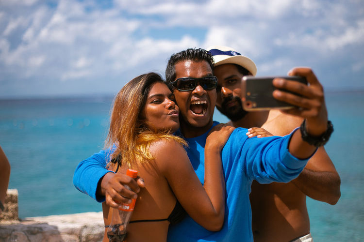 Wireless Technology Photography Themes Selfie Smart Phone Togetherness Self Portrait Photography Two People Young Adult Outdoors Millenials Indian Caribbean Sea Caribbean Life Travel Destinations Tourism Having Fun Fun Summertime Mobile Phone Sea Young Adults Sunny Day
