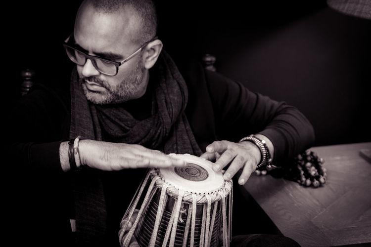 Close-up of man playing tabla