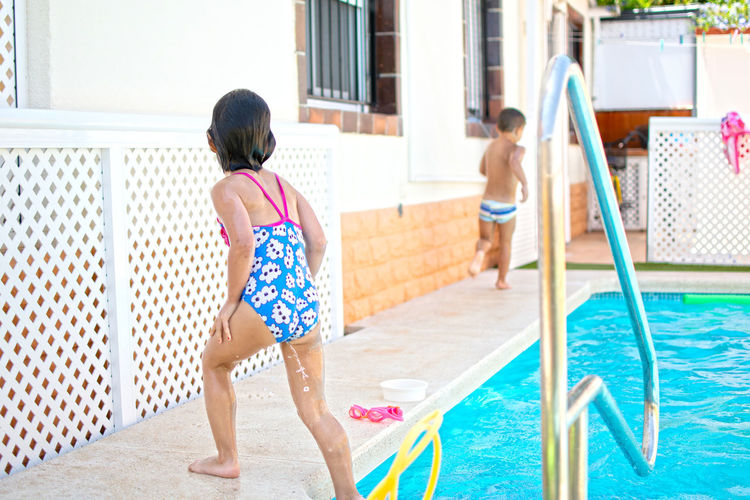 Rear view of girls in swimming pool