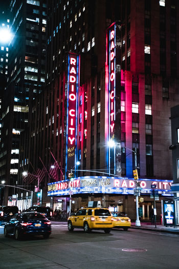 Urban Architecture City Life New York New York City City Building Exterior Street Illuminated Night City Street Sign Outdoors Nightlife Motion