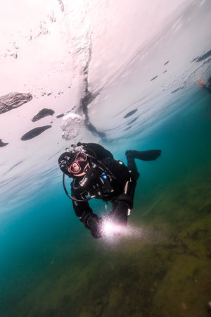 Baikal under Ice Adult Adults Only Adventure Baikal Blackandwhite Bubble Cold Dark Drysuit Exploration Ice Men One Man Only One Person Only Men RISK Russia SCUBA Scuba Diving Scuba Diving Swimming Underwater Water White Winter