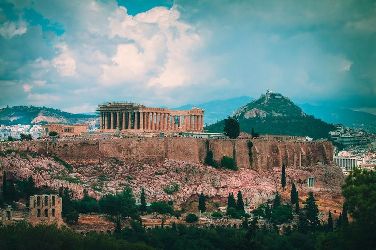 View of acropolis against cloudy sky