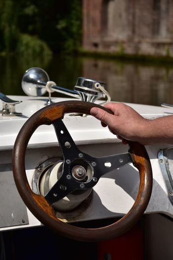 Man steering a ship in Gent, Belgium Boat Body Part Day Finger Focus On Foreground Hand Handle Holding Human Body Part Human Finger Human Hand Human Limb Lifestyles Metal Mode Of Transportation Nature One Person Outdoors Real People Ship Steering Wheel Steering Wheel Ship Transportation Unrecognizable Person Water The Great Outdoors - 2018 EyeEm Awards The Traveler - 2018 EyeEm Awards
